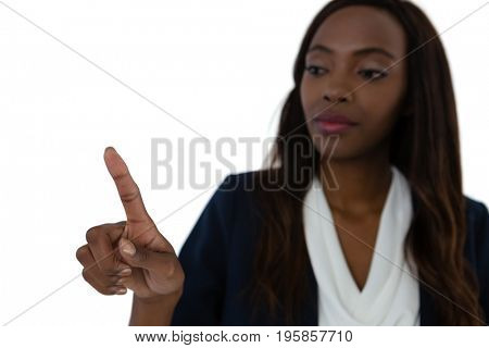 Close up of young businesswoman touching imaginary screen against white background
