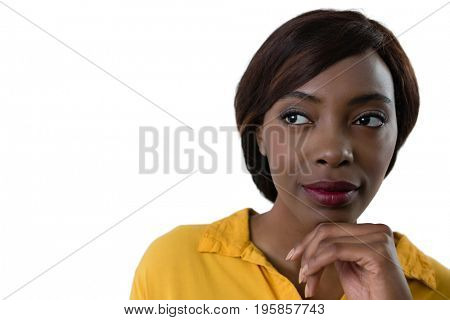 Close up of thoughtful woman with hand on chin against white background