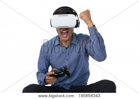 Businessman using vr glasses while playing video game against white background