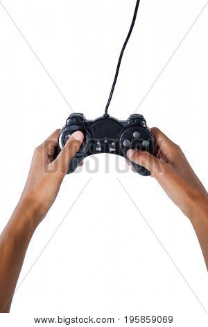 Close-up of womans hand playing video game against white background