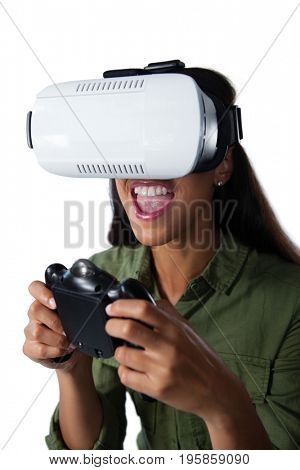 Woman playing video game with virtual reality headset against white background