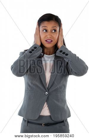 Businesswoman covering her ears. Hear no evil concept