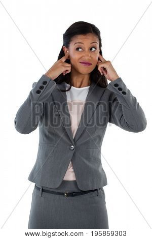 Irritated businesswoman covering her ears. Hear no evil concept
