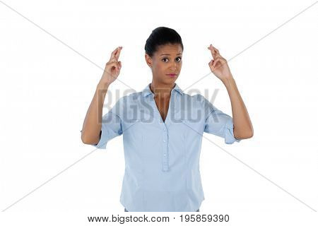 Portrait of businesswoman holding her fingers crossed