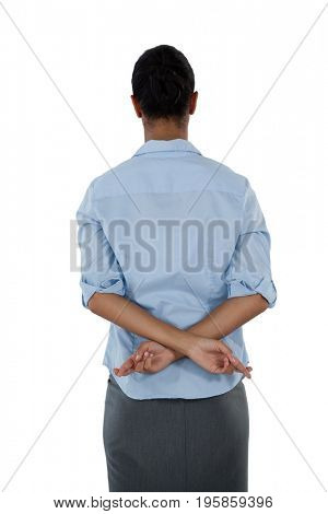 Rear view of businesswoman holding her fingers crossed behind her back