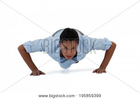 Confident businesswoman performing push ups