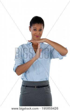 Portrait of businesswoman making a timeout hand gesture