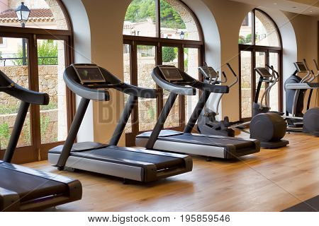 Treadmills at a window in the sports hall