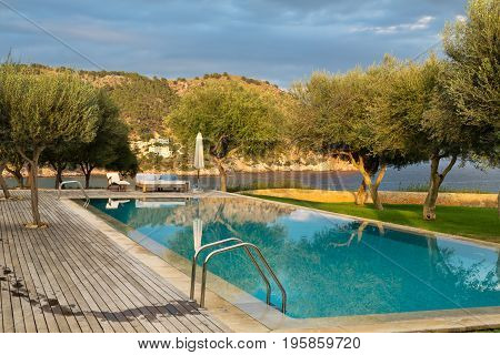 Swimming pool with a view of the trees and the sea