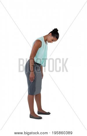 Businesswoman bending and looking down against white background