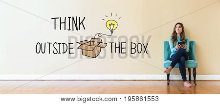 Think Outside The Box text with young woman holding a tablet computer in a chair