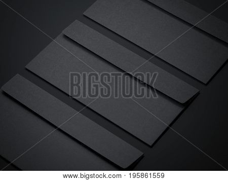 Three black blank envelopes isolated on dark background. 3d rendering