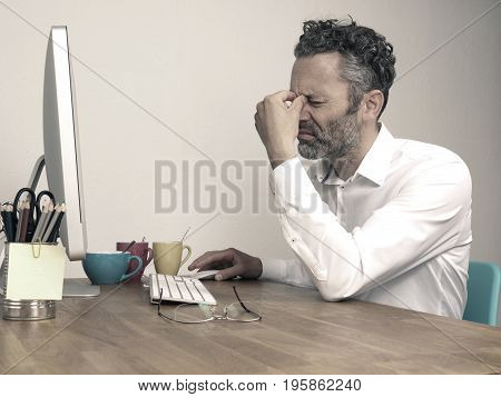 Overwork deadline business concept businessman typing on computer at night office