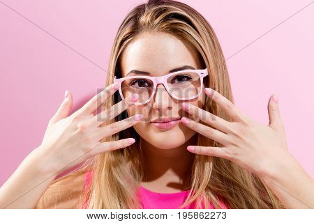 Beautiful young woman on a pink background