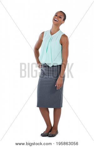 Happy businesswoman laughing against white background