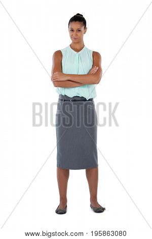 Portrait of businesswoman standing with arms crossed against white background