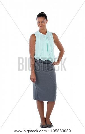 Smiling businesswoman standing with her hand on hip against white background