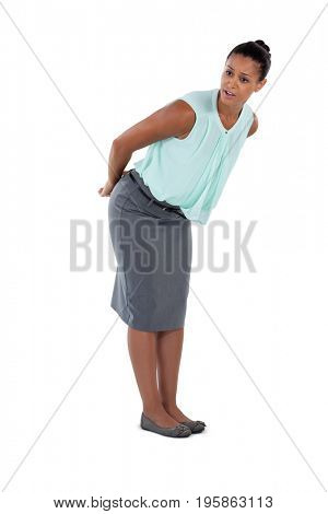 Surprised businesswoman bending and looking away against white background