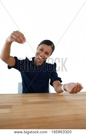 Close-up of businesswoman pretending to work on an invisible object