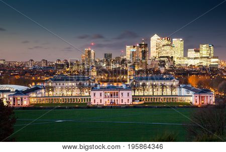 London, UK - JANUARY 7, 2016: Panoramic view from Greenwich on Canary Wharf financial district with skyscrapers at night. View includes the park, National Maritime Museum, Royal chapel and O2.