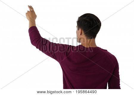 Businessman touching invisible imaginary screen against white background