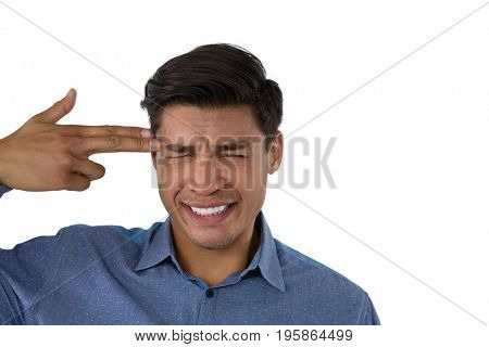 Businessman with suicide gesture against white background