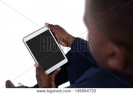 Businessman using digital tablet against white background