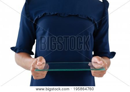 Mid section of female executive using a glass digital tablet