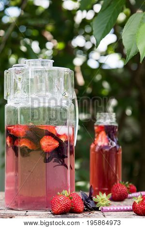 Lemonade Detox Strawberry Basil. Refreshing Drink With Fresh Strawberry And Basil On The Background