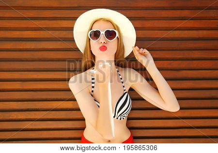 Portrait Pretty Young Woman Sends An Air Kiss In Straw Summer Hat On Wooden Background