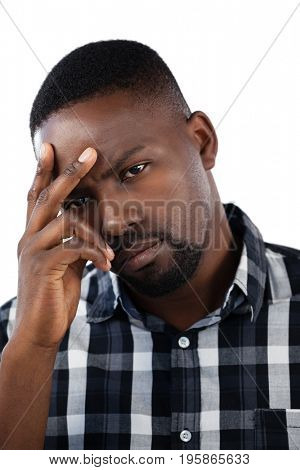 Portrait of tensed man against white background