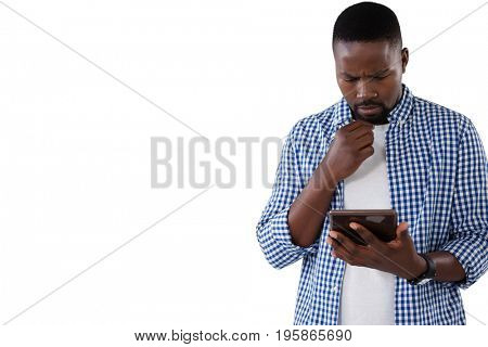 Thoughtful man using digital tablet against white background