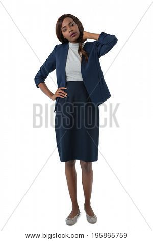Portrait of woman suffering from neck pain standing against white background