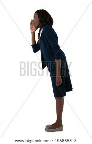 Side view of businesswoman shouting while standing against white background