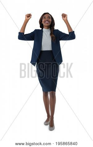Full length of cheerful businesswoman standing against white background