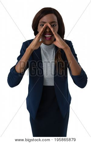 Portrait of businesswoman shouting against white background