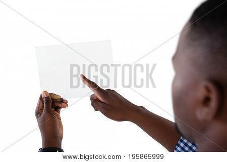Man using futuristic digital tablet against white background