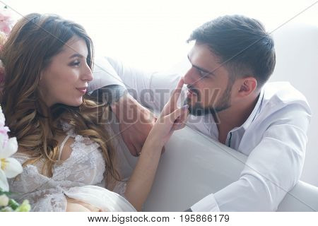 Man and beauty woman of newlyweds enjoy each other