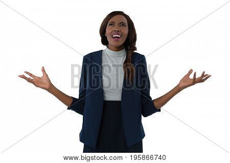Businesswoman gesturing while shouting against white background