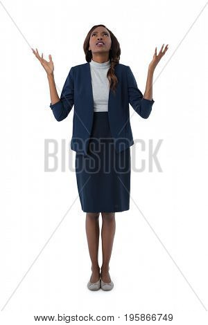 Full length of businesswoman looking up while standing against white background