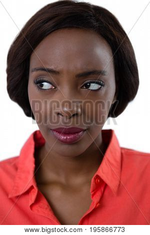 Close up of woman looking away against white background