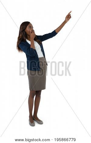 Full length of businesswoman giving presentation while standing against white background