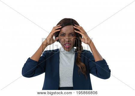 Portrait of businesswoman with head in hands standing against white background