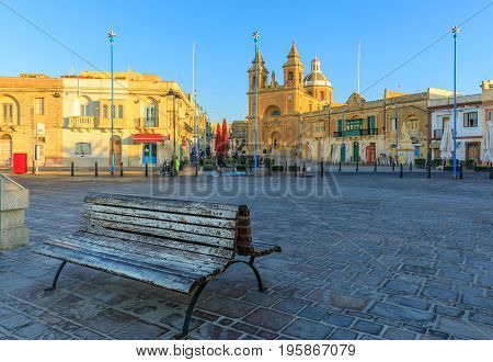 Traditional old fishing village in Malta at sunrise