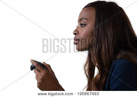 Side view of businesswoman playing video game against white background