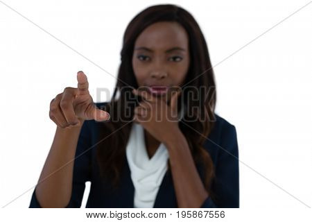 Businesswoman with hand on chin using interface screen against white background