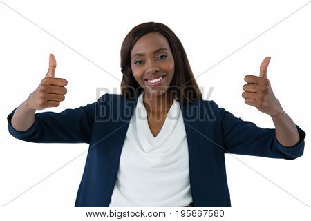 Portrait of happy businesswoman showing thumbs up gesture against white background