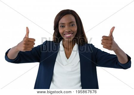 Portrait of happy businesswoman showing thumbs up against white background