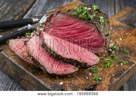 Barbecue Wagyu Point Steak sliced as close-up on a cutting board