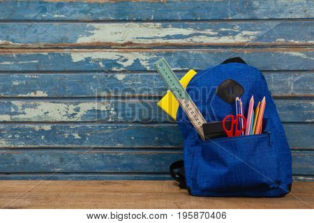 Close-up of schoolbag on wooden background